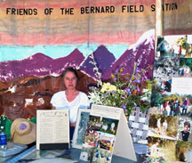 Carol Gil staffs the FBBFS display at Folk Music Festival